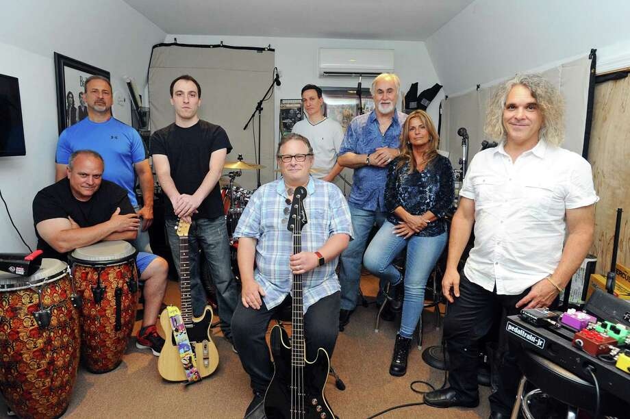 "The Stamford band Eight-track Playback pose for a photo during a rehearsal in their backyard studio on Oaklawn Avenue in Stamford, Conn. on Tuesday, July 11, 2017. The band will be performing in the Italian town of Settefrati during the festival of Madonna di Canneto, where many of the band's family are from, and will be playing American classics like the Rolling Stones' ""Sympathy for the Devil"" and AC/DC's ""Highway to Hell."" Pictured, from left, Gerard Diacri, Michael Giordano, Anthony Socci, Allan Tepper, Mario Socci, Milo Fuscaldo, Rosie Burgos and Nick Casinelli. Photo: Michael Cummo / Hearst Connecticut Media / Stamford Advocate"