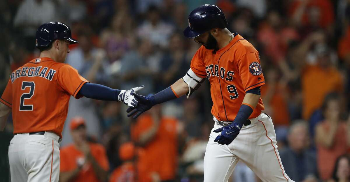 Houston Astros Marwin Gonzalez (9) celebrates his home run with Alex Bregman (2) during the third inning of an MLB baseball game at Minute Maid Park, Friday, July, 14, 2017. ( Karen Warren / Houston Chronicle )