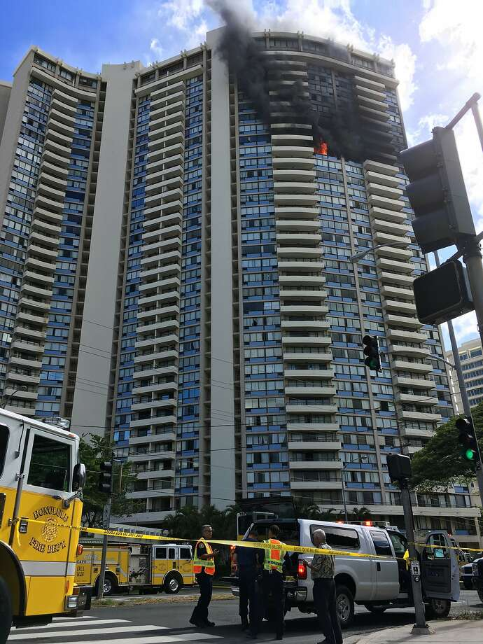Smoke rises after a fire started on the 26th floor of a Honolulu apartment building. Some residents were reported trapped. Photo: Audrey McAvoy, Associated Press
