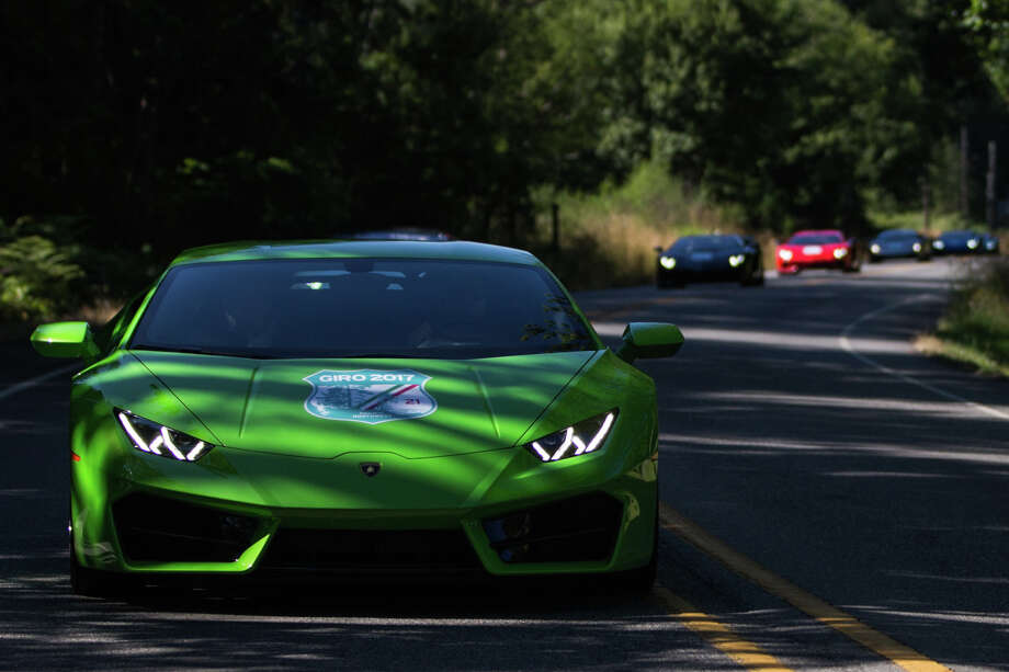 Lamborghinis roar through Bainbridge Island towards the Olympic Peninsula during Lamborghini's 2017 Giro on Friday, July 14, 2017. Photo: GRANT HINDSLEY, SEATTLEPI.COM / SEATTLEPI.COM