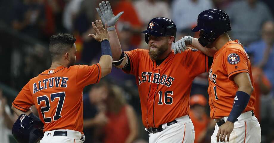 Houston Astros Brian McCann (16) celebrates his three-run home run with Jose Altuve, and Carlos Correa during the second inning of an MLB baseball game at Minute Maid Park, Friday, July, 14, 2017. ( Karen Warren / Houston Chronicle ) Photo: Karen Warren/Houston Chronicle