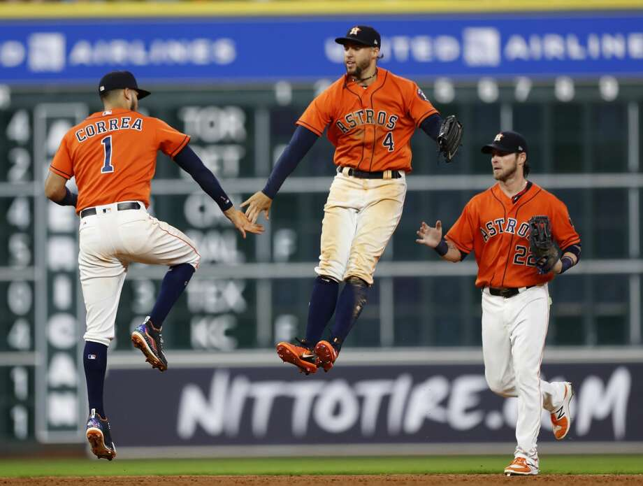 Houston Astros center fielder George Springer (4) and shortstop Carlos Correa (1) celebrate the Astros 10-5 win over Minnesota Twins after the ninth inning of an MLB baseball game at Minute Maid Park, Friday, July, 14, 2017. ( Karen Warren / Houston Chronicle ) Photo: Karen Warren/Houston Chronicle