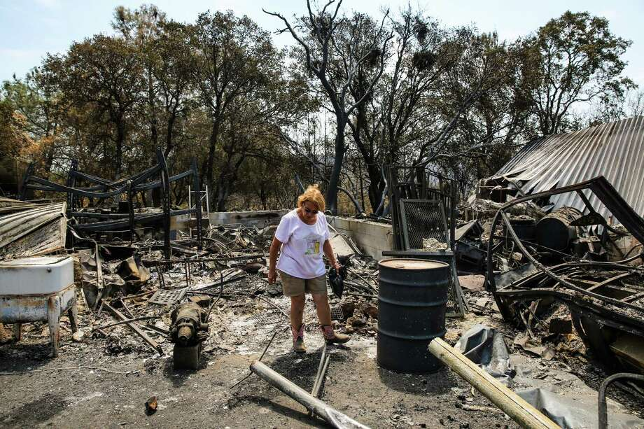 Donna Campos walks through her property on Bardolino Lane in Oroville, which was destroyed in the Wall Fire. Photo: Gabrielle Lurie / Gabrielle Lurie / The Chronicle / ONLINE_YES