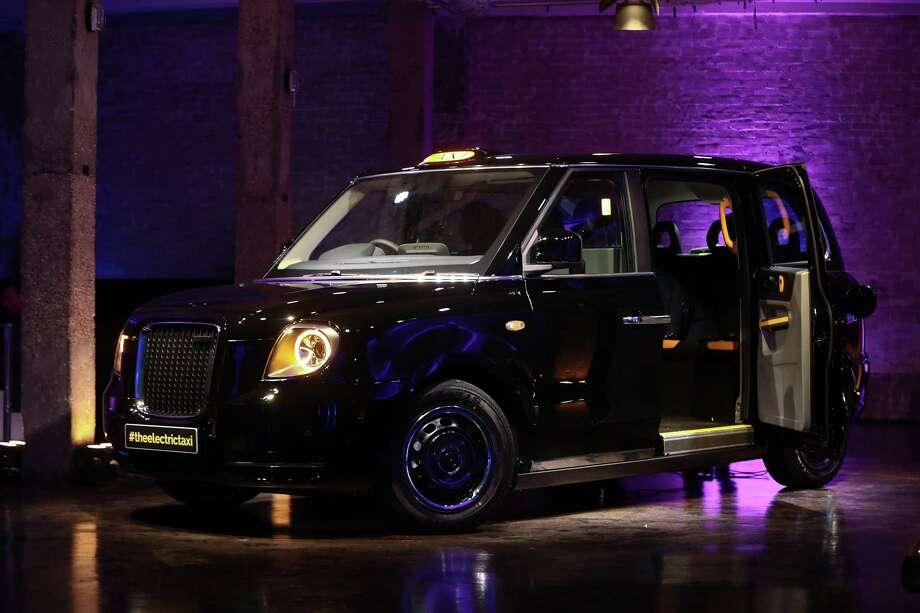 A Penger Door Sits Open On The New Tx Electric Black Taxi Manufactured By