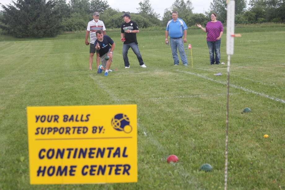 After a two-year absence, the popular Bad Axe Police Department Bocce Ball Tournament took place Friday in front of the Gathering Place. Some 30 teams battled it out for the right to be called Bad Axe's bocce champion. Photo: Seth Stapleton/Huron Daily Tribune