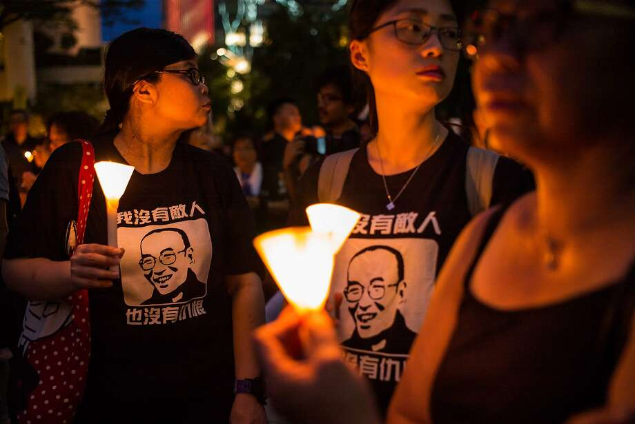 HONG KONG - JULY 15: Protesters carrying candles take part in a march to mourn the death of Nobel laureate Liu Xiaobo on July 15, 2017 in Hong Kong, Hong Kong. The body of China's most famous political prisoner, Liu Xiaobo, was cremated under government watch on Saturday in China's Shenyang city with only his widow and a few other mourners to bid farewell. Family members of Liu Xiaobo scattered the ashes of the Nobel Peace Prize-winning Chinese dissident into the sea hours after his cremation during a simple ceremony, ensuring there would be no grave on land, according to reports, as Beijing faces international criticism for not letting the Nobel laureate travel abroad as he had wished. (Photo by Billy H.C. Kwok/Getty Images) Photo: Billy H.C. Kwok, Getty Images