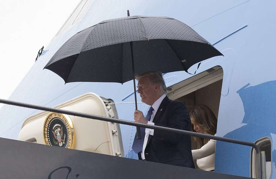 President Trump and first lady Melania Trump arrive Friday on Air Force One at Newark Liberty International Airport in New Jersey after their visit to France for Bastille Day. Photo: Carolyn Kaster, Associated Press
