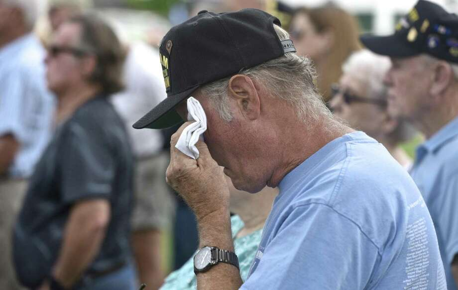 Martin Titus, of New Milford, wipes away a tear during the New Milford Veterans Committee dedication of the Vietnam Veterans Memorial, set on the Village Green, on Saturday morning, July 15, 2017, in New Milford, Conn. Titus served in the Army from 1969 to 1972. Photo: H John Voorhees III / Hearst Connecticut Media / The News-Times