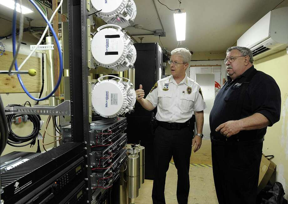 Ridgefield Police Chief John Roche, left, and Dick Aarons, left, duputy emergency manager for the town, talk about a project nearing completion that replaces the Ridgefield's emergency communications radio system, Thursday, August 18, 2016. Photo: Carol Kaliff / Hearst Connecticut Media / The News-Times