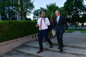 Congressman Will Hurd (left) walks into the federal courthouse Saturday morning to give testimony in a redistricting trial.