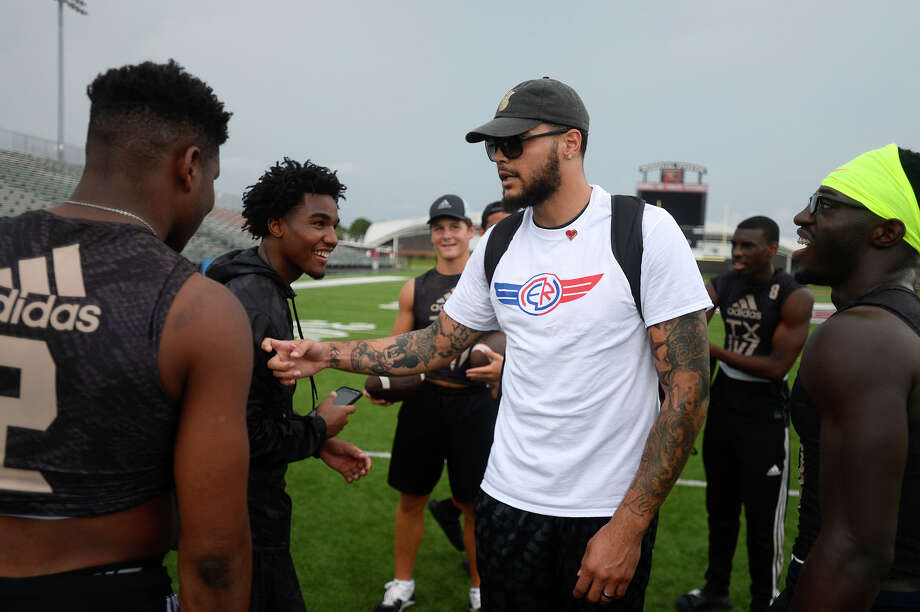 Tampa Bay Buccaneers wide receiver Mike Evans jokes with players from the Fast Houston team during New England Patriots linebacker Elandon Roberts' charity 5K and 7-on-7 football tournament in Port Arthur on Saturday. Roberts, who went to Memorial High School, held the event to raise awareness of heart disease.  Photo taken Saturday 7/15/17 Ryan Pelham/The Enterprise Photo: Ryan Pelham / ©2017 The Beaumont Enterprise/Ryan Pelham