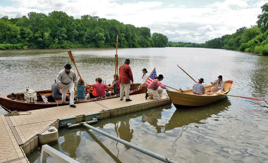 Visitors get a lesson in rowing an 18C. Mohawk River bateaux from re-enactors during CanalFest at Mabee Farm Saturday July 15, 2017 in Rotterdam Junction, NY.  (John Carl D'Annibale / Times Union) Photo: John Carl D'Annibale / 40041022A
