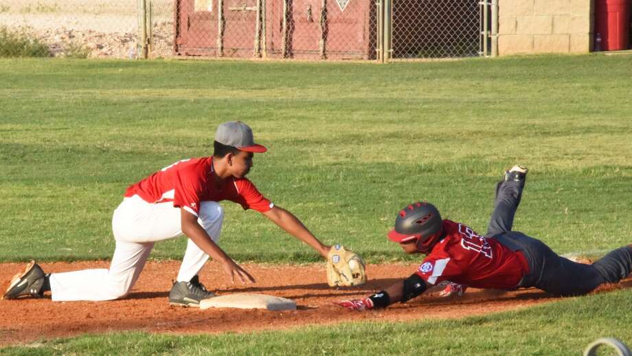Plainview's Tyler Rodriguez dives back to third base as the third baseman moves to tag him during a Babe Ruth 14-year-old state tournament game last week. Plainview will host the Southwest Regional beginning Friday. Photo: Photo Courtesy Of Paula Lusk
