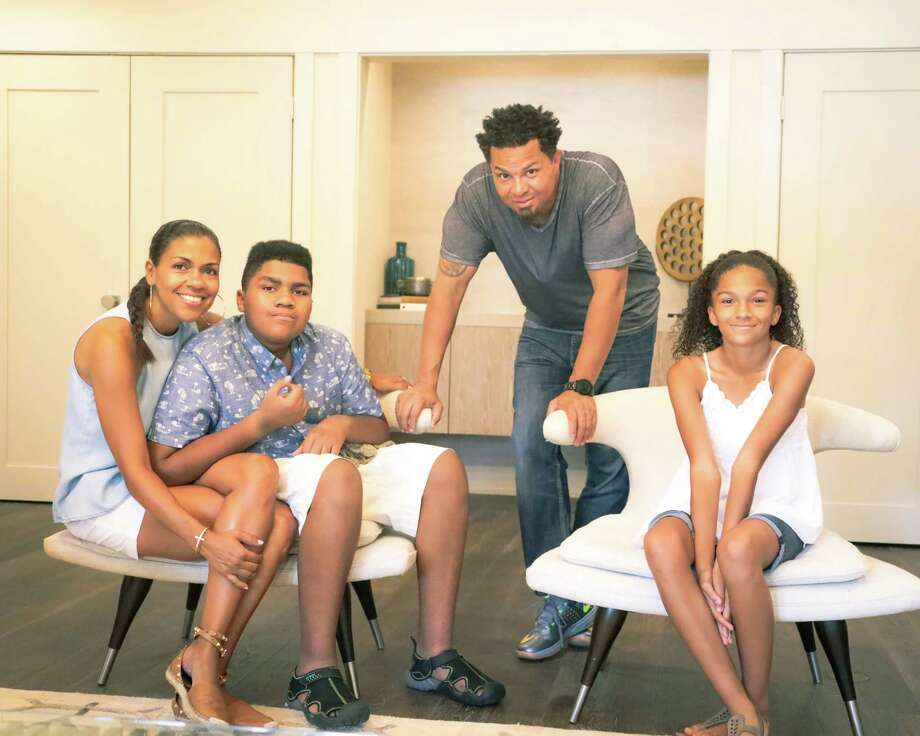 Debra and Ahmad Islam are seeking a jewelry designer to create a line of pieces that would identify autism to law enforcement. Their children are 11-year-old Selena and 14-year-old Gabriel, who has autism. Photo: Joe Center
