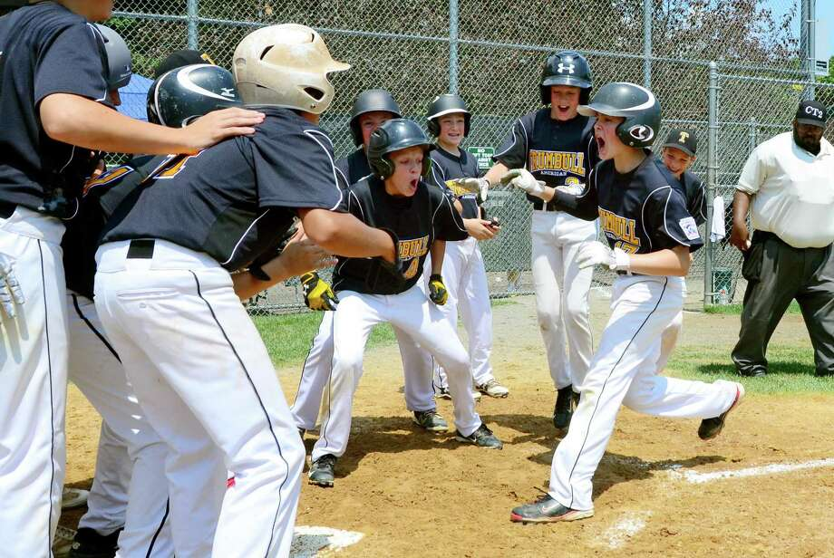 Trumbull's Scott Gell heads to home plate and cheering teammate after hitting a grand slam home run during District 2 little league Championship baseball action against Fairfield National in Trumbull, Conn., on Saturday July 15, 2017. Photo: Christian Abraham / Hearst Connecticut Media / Connecticut Post