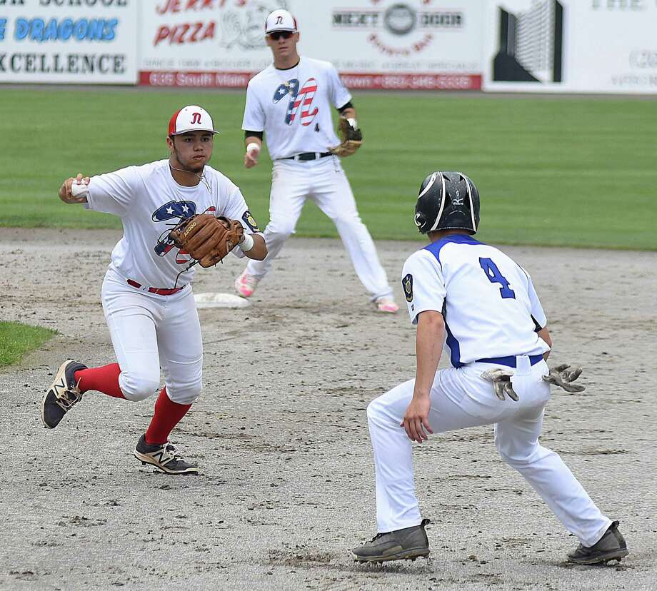 Norwalk's Mo Ortiz-Echeverria, left, catches Middletown's Tim Dickson off first base for a run-down out during Saturday's American Legion baseball state tournament opening-round game at Palmer Field in Middletown. Host Middletown won 5-0. Photo: John Nash / Hearst Connecticut Media