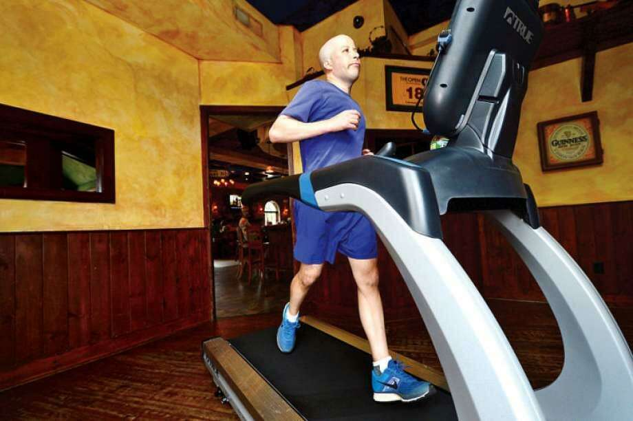 "Norwalk resident Jimmy Booth participates in the ""Run in the Pub"" charity event at O'Neill's Pub & Restaurant, happening this Saturday from 11 a.m. to 5 p.m. Photo: Erik Trautmann / Hearst Connecticut Media File"