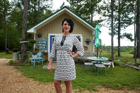Carly McKenzie, shown outside her business Bay Creek Salon in Lumberton, Miss., wears a white patterned chiffon dress from the Ivanka Trump line in June. M