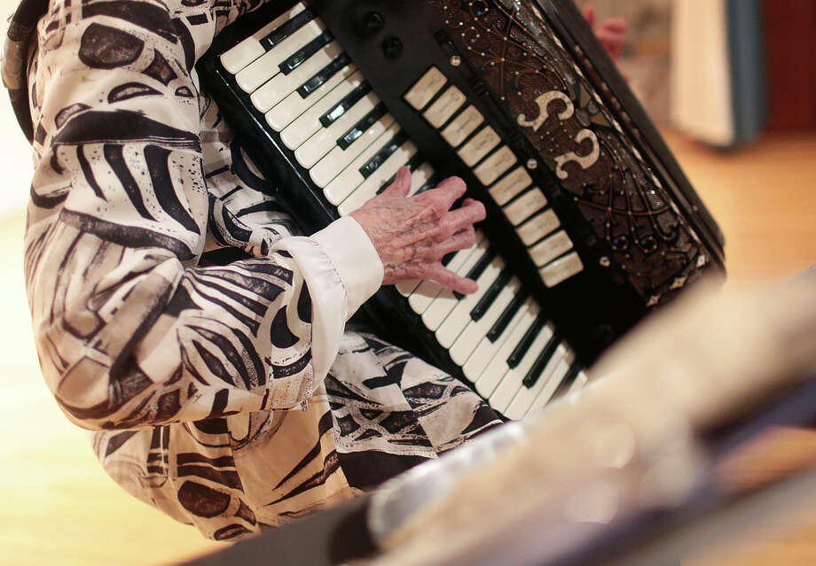 FILE - In this Thursday, Feb. 16, 2017, file photo, a woman plays an accordion as she tries out for a talent contest for seniors at an arts center in Scranton, Pa. While there's nothing you can do or take to ensure you won't get Alzheimer's disease, experts say there are some strategies that might help delay the normal mental decline due to aging. Research on the issue isn't conclusive, but there are hints that getting more exercise and challenging your mind with new ideas and complex activities such as learning to play a musical instrument and going out with friends can help keep the brain sharp. (Jake Danna Stevens/The Times & Tribune via AP, File) ORG XMIT: PASCR331 Photo: Jake Danna Stevens / The Times & Tribune