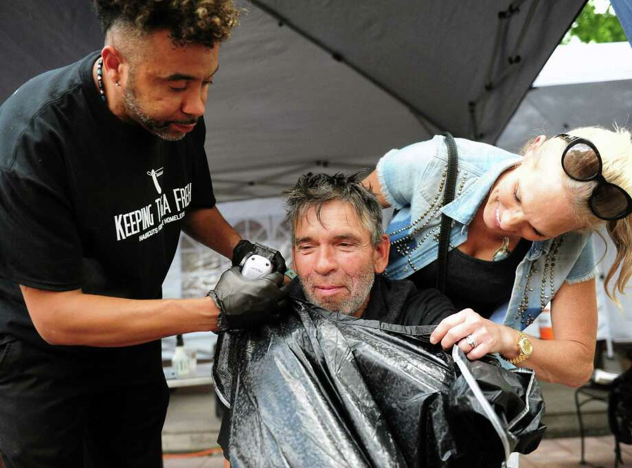 Saratoga resident Kevin Germaine has his hair cut Saturday, July 15, 2017. He and about 20 other people who are or were recently homeless received free haircuts from local barbers Jesse White and Rasi Harper. (Robert Downen/Times Union) Photo: Robert Downen / Times Union