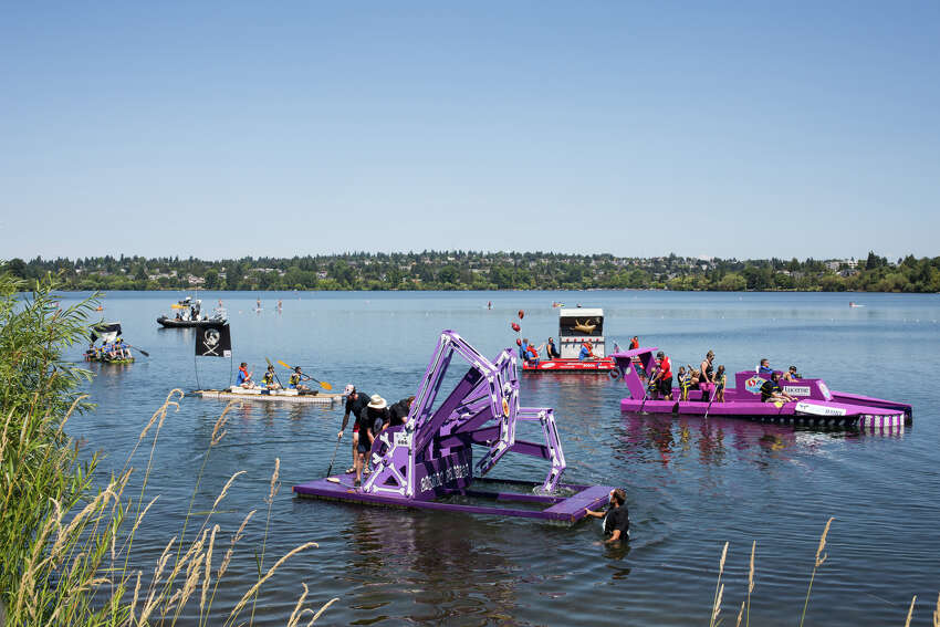 A menagerie of cardboard, wood and milk carton boats strut their stuff one last time during Seafair's annual Milk Carton Derby on Green Lake, Saturday, July 15, 2017.