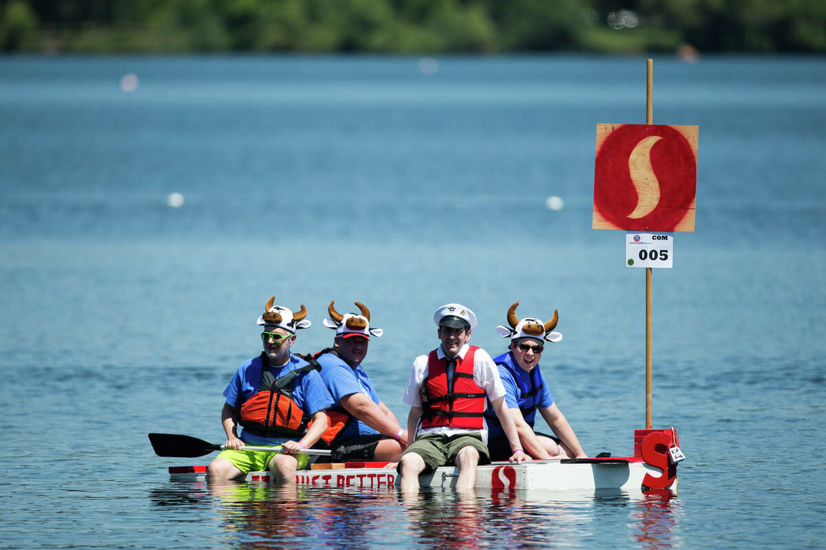 A local Safeway store's milk carton boat prepares to race during Seafair's annual Milk Carton Derby on Green Lake, Saturday, July 15, 2017.