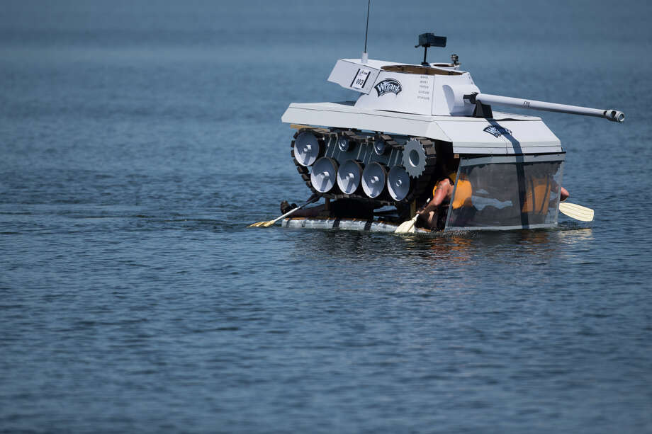 Wizards of the Coast's tank-shaped boat struggles during its race during Seafair's annual Milk Carton Derby on Green Lake, Saturday, July 15, 2017. Photo: GRANT HINDSLEY, SEATTLEPI.COM / SEATTLEPI.COM