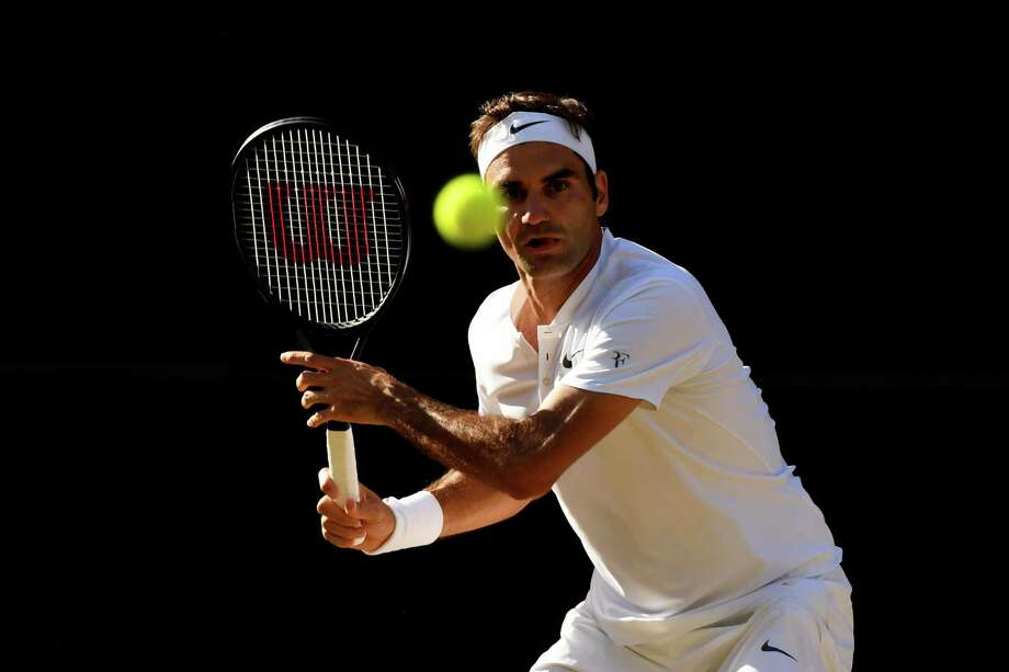 LONDON, ENGLAND - JULY 14:  Roger Federer of Switzerland watches the ball during the Gentlemen's Singles semi final match against Tomas Berdych of The Czech Republic on day eleven of the Wimbledon Lawn Tennis Championships at the All England Lawn Tennis and Croquet Club at Wimbledon at Wimbledon on July 14, 2017 in London, England.  (Photo by Shaun Botterill/Getty Images) Photo: Shaun Botterill / Getty Images / 2017 Getty Images