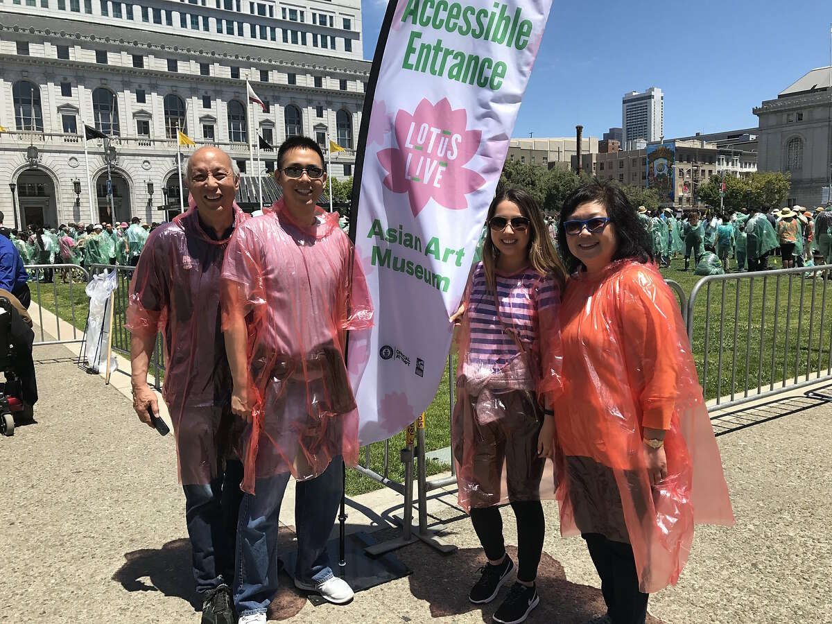 Calvin and Esther Li with their son Eric and Tina Lu participated in Saturday's human lotus event organized by the Asian Art Museum.