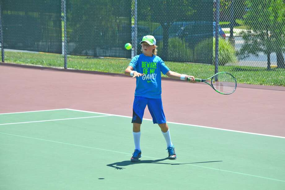 Colton Hulme, 11, of Edwardsville, competes in a boys' 12 singles match on Saturday at the SLTL-NET Edwardsville Junior Satellite tournament at the Edwardsville High School Tennis Center.