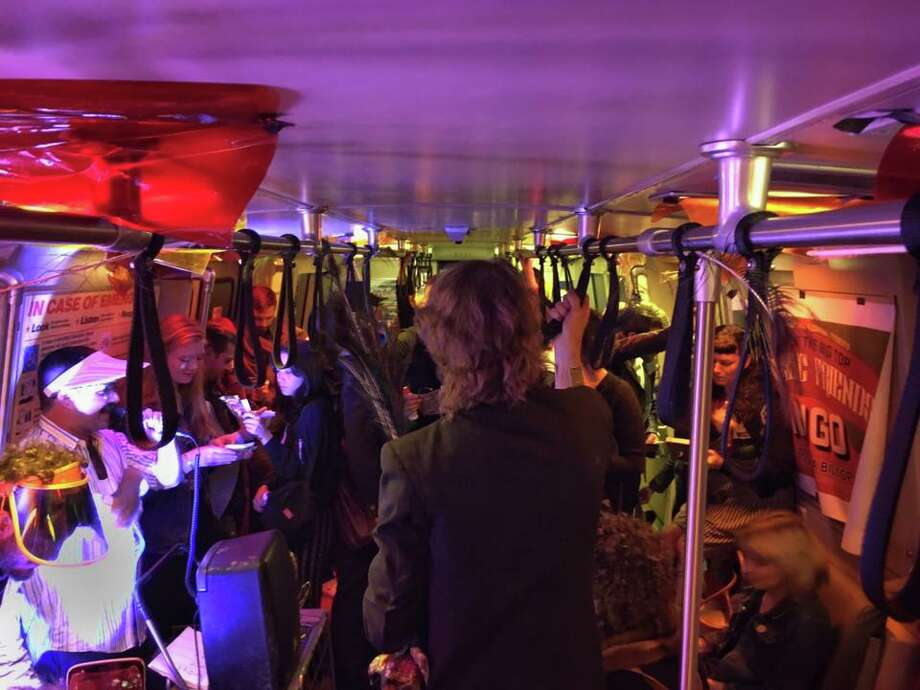 A group called the Growing Artist Guild took over a BART car heading into SF and threw a psychedelic bingo party on Friday, July 14. The event was called Bay Area Rapid Bingo. Photo: Mischa Steiner