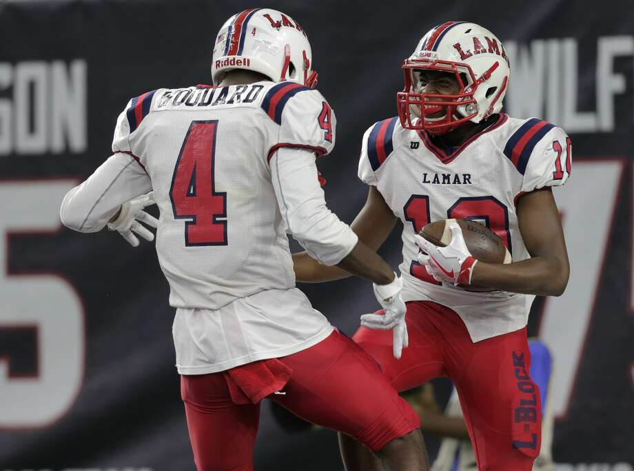 Lamar's Denzel Davis (10) and Al'Vonte Woodard (4) celebrate Davis' touchdown in the Class 6A, Division I region semifinals between against Atascocita at NRG Stadium on Friday, Nov. 25, 2016, in Houston. Atascocita won 28-27. ( Elizabeth Conley / Houston Chronicle ) Photo: Elizabeth Conley/Houston Chronicle