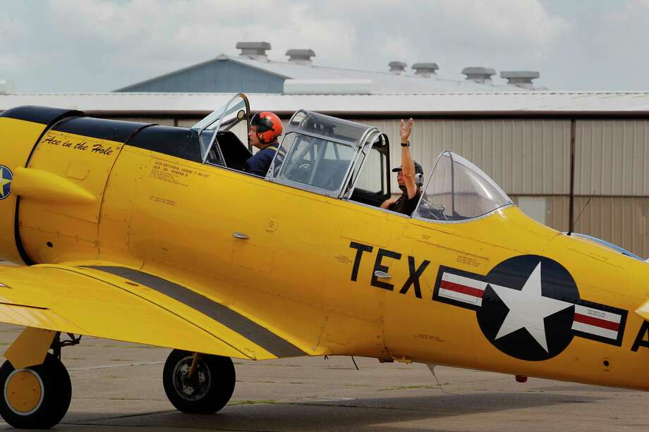 Pilot Charlie Hainline (left) takes Steve Giesler on a flight in a T-6 aircraft at the Lone Star Flight Museum, Saturday, July 15, 2017, in Galveston. The LSFM will close its doors on the Galveston location July 15th and will thank the Galveston community with a farewell event. This all-day event is an opportunity for media to tour the Galveston museum one last time and meet the volunteers, staff and pilots who are helping create an all new LSFM experience at Ellington Airport. ( Steve Gonzales  / Houston Chronicle ) Photo: Steve Gonzales, Staff / © 2017 Houston Chronicle