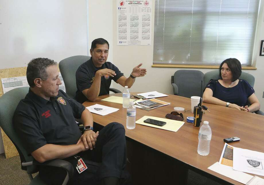 San Antonio firefighters James Gonzales (left), Raul Chapa (center) and Yvonne Garcia speak June 20, 2017, about grief counseling and the fire department's Critical Incident Stress Debriefing Team. Garcia is a paramedic and a licensed professional counselor intern. They are helping fire department personnel cope with the death of firefighter Scott Deem. Two firefighters, Robert Vasquez and Brad Phipps, were injured. Photo: John Davenport /San Antonio Express-News / San Antonio firefighters