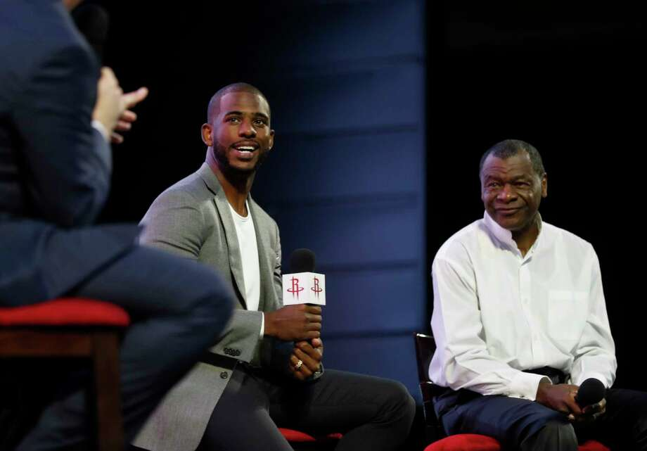 New Rockets guard Chris Paul speaks to Houston fans during his introduction Friday at Toyota Center. The size of the crowd that greeted Paul and his family was a testament to his popularity. Photo: Karen Warren, Staff Photographer / 2017 Houston Chronicle