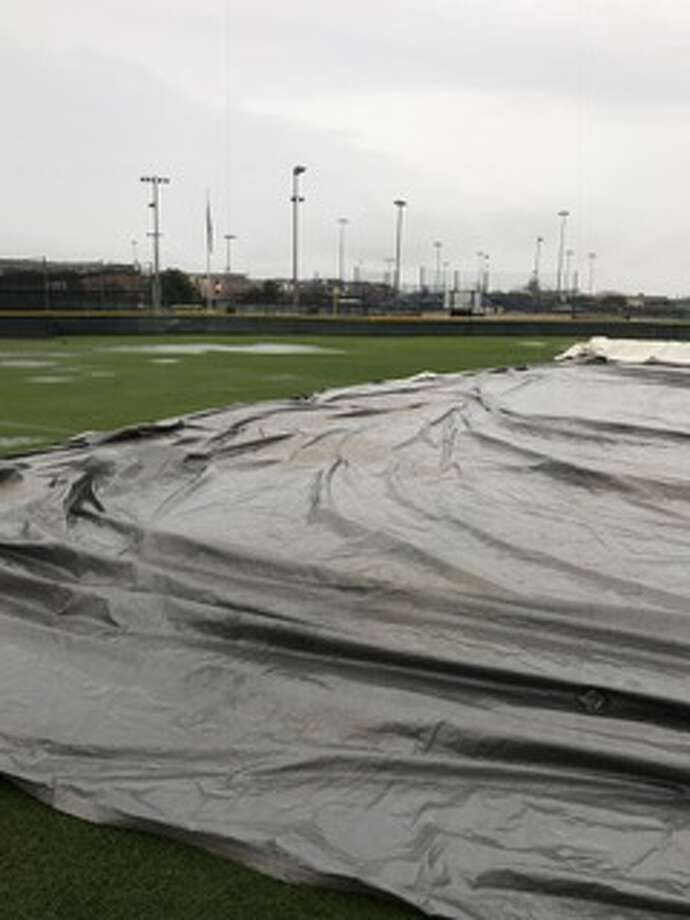 A tarp covers one of the fields at the West University Little League complex Saturday night. Officials will try again Sunday to get the Texas East State Championship Tournament underway. Photo: Robert Avery