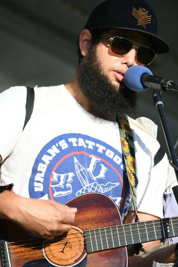 Joe Hertler and the Rainbow Seekers performs during Riverdays on Saturday in Midland. Photo: (Steven Simpkins/for The Daily News)