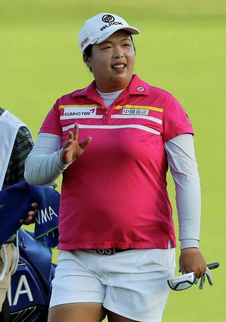 BEDMINSTER, NJ - JULY 15:  Shanshan Feng of China greets the fans as she approaches the 18th green during the U.S. Women's Open round three on July 15, 2017 at Trump National Golf Club in Bedminster, New Jersey.  (Photo by Elsa/Getty Images) Photo: Elsa, Staff / 2017 Getty Images