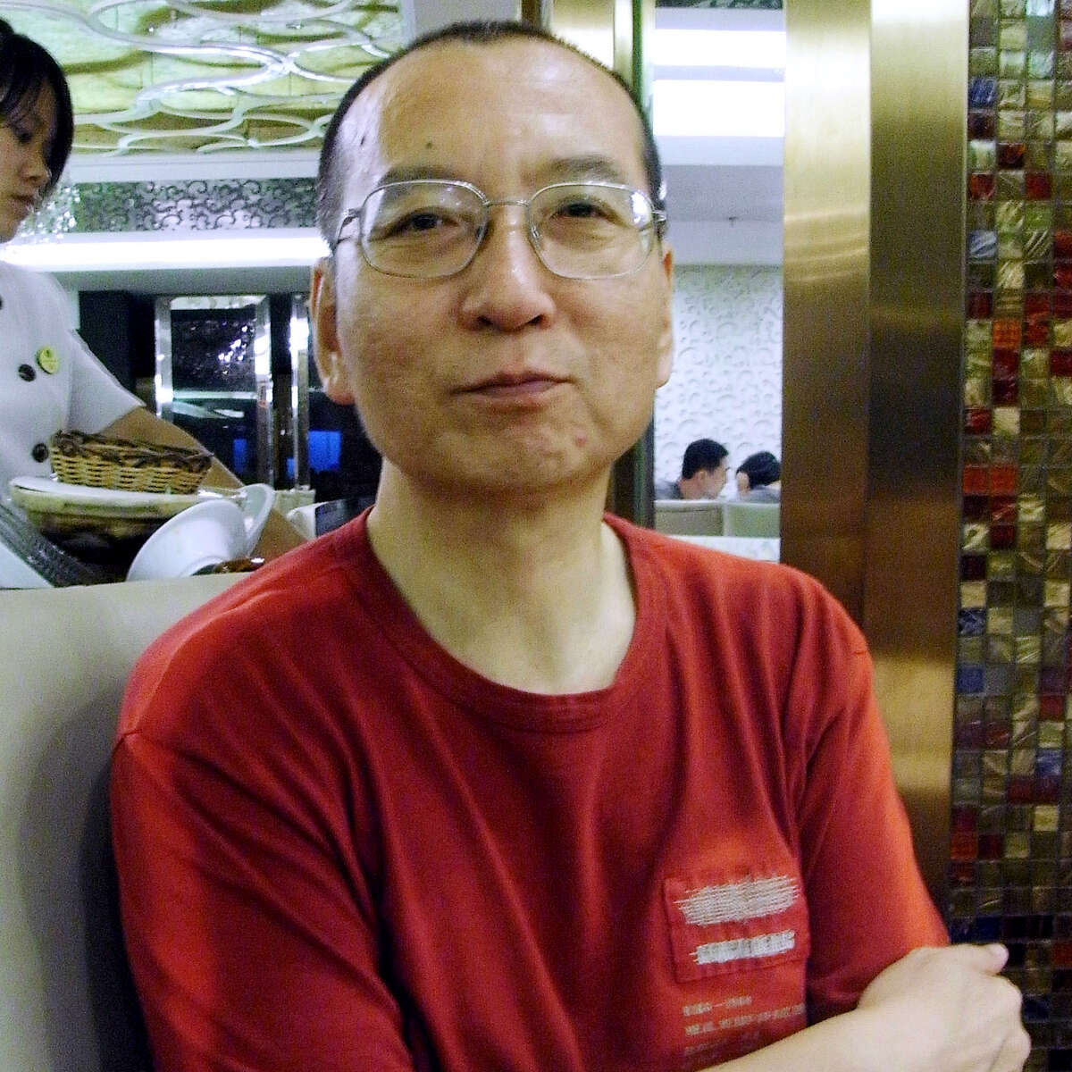 FILE - In this July 30, 2008 photo, Chinese dissident Liu Xiaobo speaks during an interview with Japan's Kyodo News in Beijing. Liu died Thursday, July 13, 2017, of liver cancer while serving an 11-year sentence for incitement to subvert state power. He was 61. As tributes rolled in Friday, July 14, 2017, to mourn China's most famous political prisoner Liu, a newspaper published by the ruling Communist Party dismissed late Nobel Peace Prize laureate Liu as a pawn of the West whose legacy will soon fade. (Kyodo News via AP)