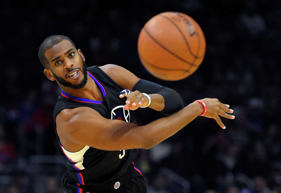 New Rockets guard Chris Paul makes no bones about his desire to win an NBA championship with his new team. Paul, 32, is on his third NBA team and his competitive spirit is well known around the league. Photo: Mark J. Terrill, STF / AP