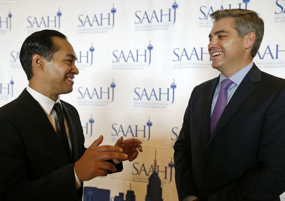 Former Housing and Urban Development Secretary and San Antonio Mayor Julian Castro (left) talks with San Antonio Association of Hispanic Journalist keynote speaker Jim Acosta, CNN Senior White House Correspondent,  during the San Antonio Association of Hispanic Journalists 19th annual Scholarship & Awards Gala held at the Grand Hyatt Saturday July 15, 2017. Acosta received the 2017 Corazon de Oro Award. Photo: Edward A. Ornelas, Staff / San Antonio Express-News / © 2017 San Antonio Express-News