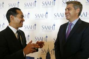 Former Housing and Urban Development Secretary and San Antonio Mayor Julian Castro (left) talks with San Antonio Association of Hispanic Journalist keynote speaker Jim Acosta, CNN Senior White House Correspondent,  during the San Antonio Association of Hispanic Journalists 19th annual Scholarship & Awards Gala held at the Grand Hyatt Saturday July 15, 2017. Acosta received the 2017 Corazon de Oro Award.