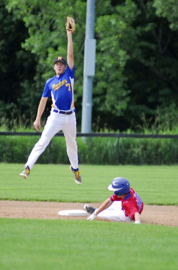 Action from the U15 Babe Ruth Baseball final between Newtown and Stamford on Saturday. Photo: Ryan Lacey / Hearst Connecticut Media