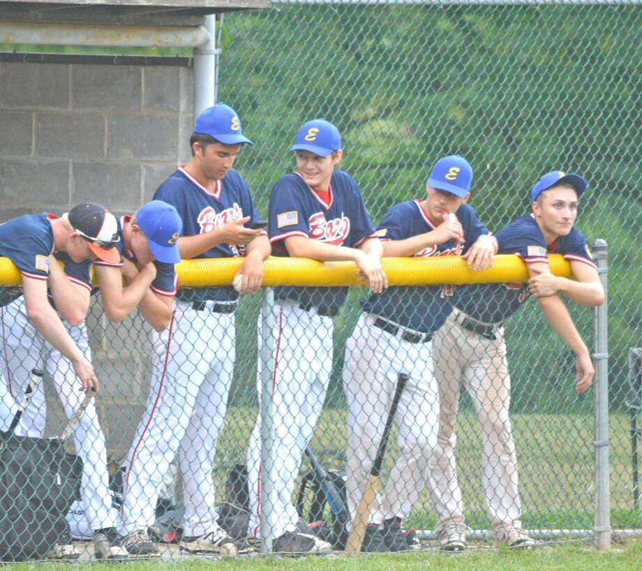 Edwardsville Bears players watch from the dugout during Thursday's District 22 tournament game against Highland at Hoppe Park.