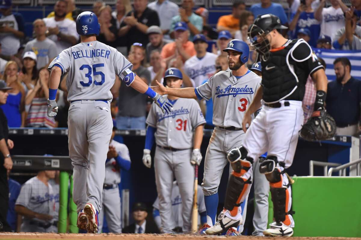 MIAMI, FL - JULY 15: Chris Taylor #3 of the Los Angeles Dodgers congratulates Cody Bellinger #35 after he hit a home run in the third inning against the Miami Marlins at Marlins Park on July 15, 2017 in Miami, Florida. (Photo by Eric Espada/Getty Images)