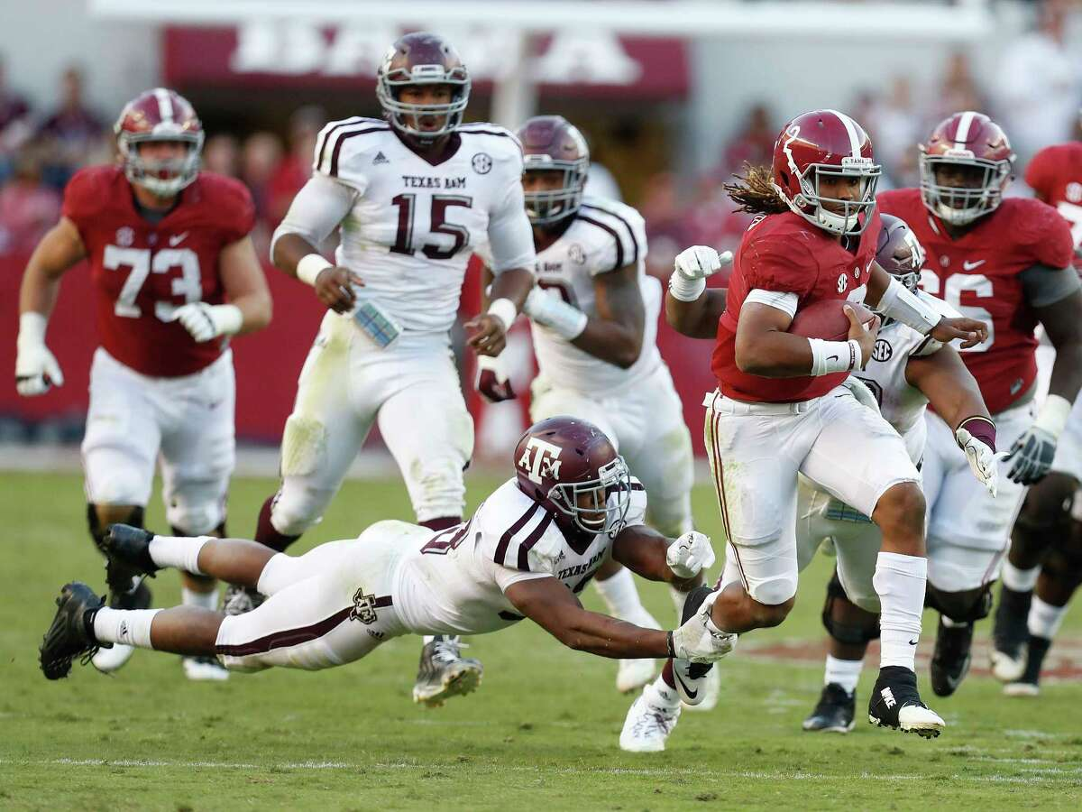 Last season former Channelview standout Jalen Hurts, right with ball, became the first true freshman to start at quarterback at Alabama in 30 years.