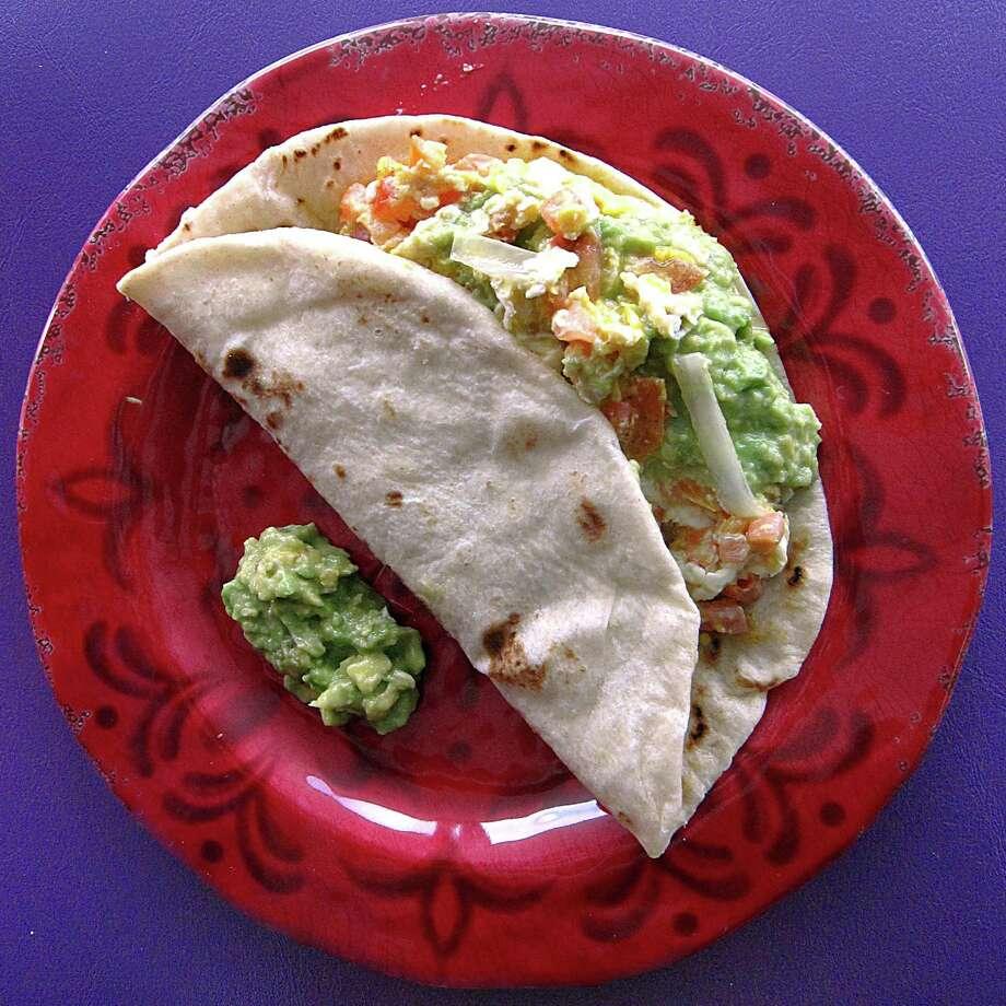 Huevos a la mexicana taco with guacamole on a handmade flour tortilla from Cristan's Tacos. Photo: Mike Sutter /San Antonio Express-News