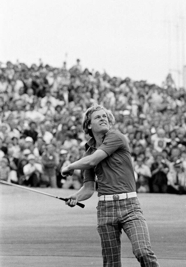 FILE - In this July 10, 1976, file photo, American golfer Johnny Miller throws his golf ball to the crowd after winning the British Open Golf Championship at the Royal Birkdale golf course in Southport, England. Miller won the Open with a six-stroke victory from Jack Nicklaus and Spain's Severiano Ballesteros, who tied for second place. Miller went round in 279, Nicklaus and Ballesteros in 285. Miller returns to Royal Birkdale for the first time in 26 years as the lead analyst for NBC. (AP Photo/File) Photo: Associated Press