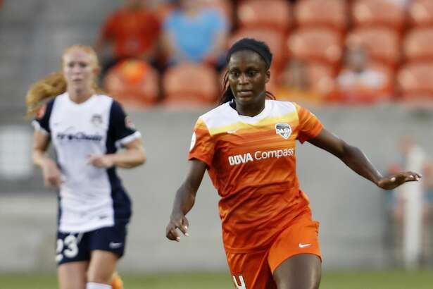 Houston Dash forward Nichelle Prince (14) dribbles the ball in the first half during the NWSL game between the Washington Spirit and Houston Dash on Saturday July 15, 2017.  The Dash lead the Spirit 1-0.