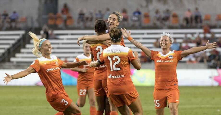Houston Dash forward Rachel Daly (3), midfielder Amber Brooks (12), and defender Janine Van Wyk (55) celebrate with defender Poliana Barbosa Medeiros (2) after a goal in the first half during the NWSL game between the Washington Spirit and Houston Dash on Saturday July 15, 2017.  The Dash lead the Spirit 1-0. Photo: Tim Warner/For The Chronicle